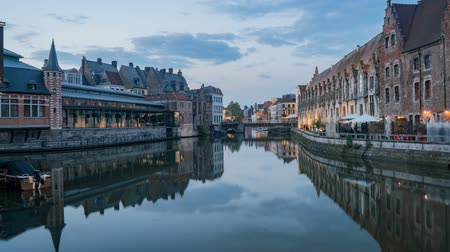 bruxelas : Pan motion timelapse video of the beautiful cityscape and Leie river from afternoon to sunset at Ghent, Belgium