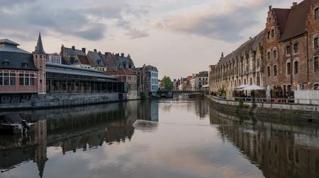 yüksek çözünürlüklü : Timelapse video of the beautiful cityscape and Leie river from afternoon to sunset at Ghent, Belgium Stok Video