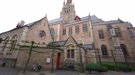 bruges : Exterior view of the famous Church of Our Lady Bruges and Juan Luis Vives, Belgium Stock Footage