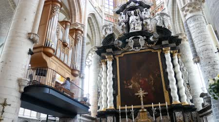 brüksel : Ghent, APR 28: Woman playing pano in the historical Saint Nicholas Church on APR 28, 2018 at Ghent, Belgium Stok Video