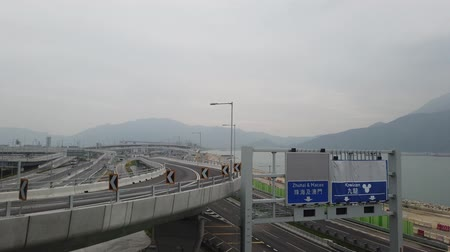 nublado : Bus driving on the new Hong Kong - Zhuhai - Macau Bridge in a Cloudy day