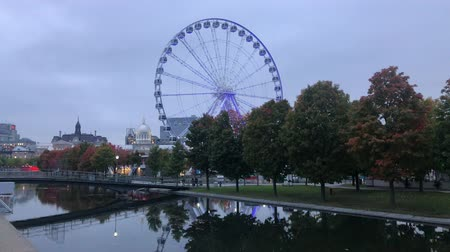 grande : Twilight view of the beautiful fall color with the La Grande Roue de Montreal observation ferris wheel at Montreal, Canada Stock Footage