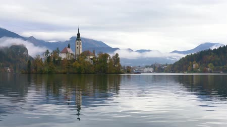 assumption : Beautiful autumn landscape around Lake Bled with Pilgrimage Church of the Assumption of Maria at Slovenia