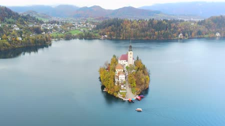 assumption : Aerial view of the famous Lake bled with the tiny island and Pilgrimage Church of the Assumption of Maria at Slovenia Stock Footage