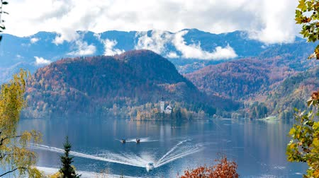 dumanlı sis : Aerial timelapse of the famous Lake bled with the tiny island and Pilgrimage Church of the Assumption of Maria at Slovenia