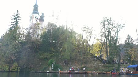 pilgrimage : Slovenia, NOV 3: Beautiful autumn landscape around Lake Bled with Pilgrimage Church of the Assumption of Maria on NOV 3, 2018 at Slovenia