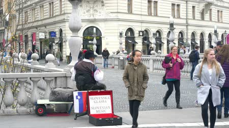 ljubljana : Ljubljana, NOV 3: Street artist performaning music in the street of Prešeren Square on NOV 3, 2018 at Slovenia
