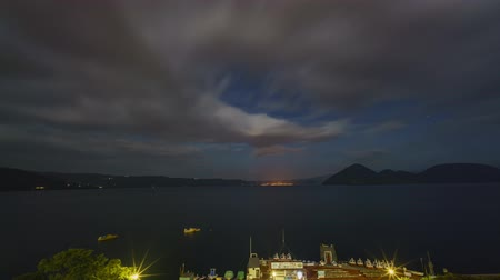 fuji : Sunset, night timelapse of the famous Lake Toya with Mount Yotei at Hokkaido, Japan