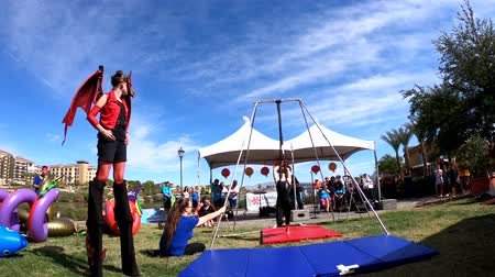 yat yarışı : Las Vegas, OCT 13: Young girl performaning gymnastics in the famous Rose Regatta Dragon Boat Festival on OCT 13, 2018 at Las Vegas, Nevada Stok Video