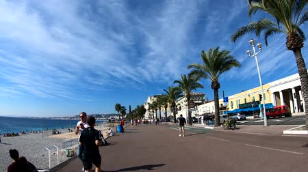 沿岸の : Nice, OCT 21: Many people enjoying the beautiful beach, water, blue sky along the famous Angels Bay on OCT 20, 2018 at Nice, France