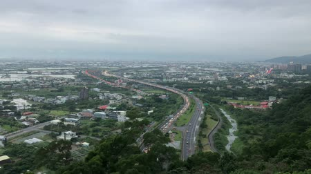 típico : Aerial view of the highway 5 with traffic and cityscape of Toucheng Township at Yilan, Taiwan Stock Footage