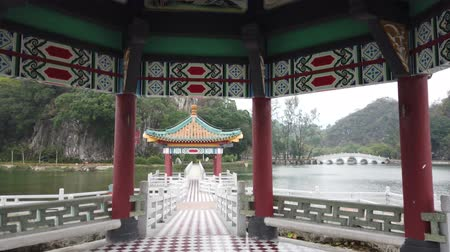 five star : Walking in the Five dragon pavilion of Seven-star Crags Scenic Area at Zhaoqing, China Stock Footage