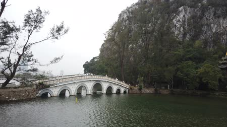 hét : Seven star bridge, mountains around Seven-star Crags Scenic Area at Zhaoqing, China Stock mozgókép