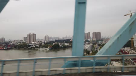 провинция : Cityscape of town center on a high speed rail near Zhaoqing, China Стоковые видеозаписи