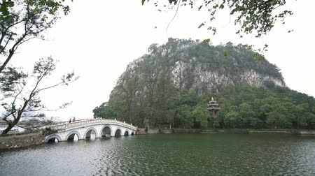 yedi : Seven star bridge, mountains around Seven-star Crags Scenic Area at Zhaoqing, China Stok Video