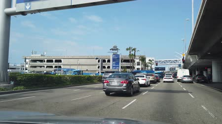 vastlopen : Los Angeles, APR 1:  Driving towrads the busy LAX International Airport on APR 1, 2019 at Los Angeles, California Stockvideo