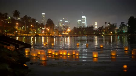 los angeles skyline : Close up of many lantern with downtown skyline in Lotus Festival Echo Park at Los Angeles, California Stock Footage