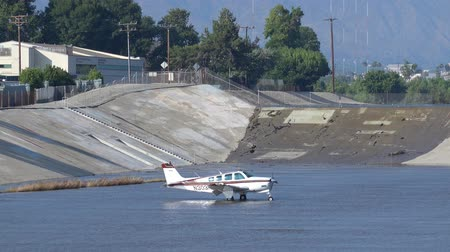 sheriff : El Monte, JUN 27: Airplane landed at Rio Hondo wash canal, and police, firefigther were standby on JUN 27, 2019 at El Monte, Los Angeles County Stock Footage