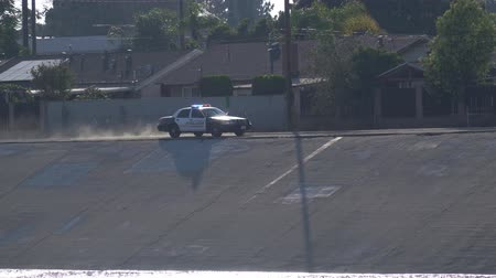 sheriff : El Monte, JUN 27: Police car driving very fast along the Rio Hondo wash canal on JUN 27, 2019 at El Monte, Los Angeles County