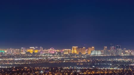 las vegas boulevard : Night timelapse of the famous Las Vegas Strip skyline with mountain behind at Nevada