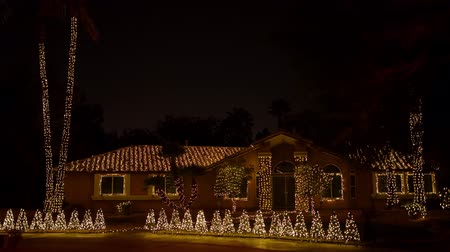 izzók : Las Vegas, DEC 12: Night view of the colorful Christmas home on DEC 12, 2019 at Las Vegas, Nevada Stock mozgókép