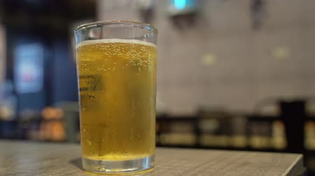 tajvan : Close up shot of glass of cold beer at Taipei, Taiwan Stock mozgókép