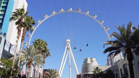 zipline : Las Vegas, Jan 11: Afternoon sunny view of the famous High Roller and people sliding the FlyLinq Zipline on JAN 11, 2020 at Las Vegas, Nevada