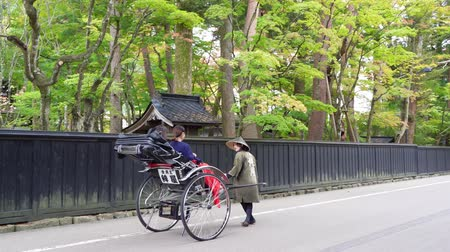risciò : Kakunodate, OCT 21: Visitor sit in pulled rickshaw enjoying the view of Kakunodate Samurai House on OCT 21, 2019 at Kakunodate, Japan