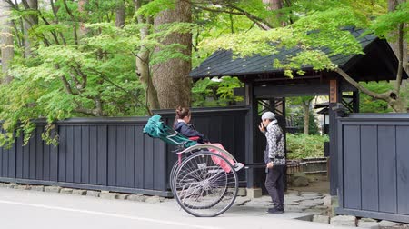 samoerai : Kakunodate, OCT 21: Visitor sit in pulled rickshaw enjoying the view of Kakunodate Samurai House on OCT 21, 2019 at Kakunodate, Japan