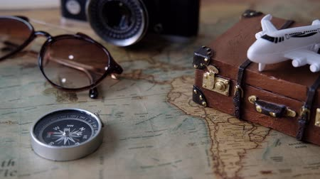 Toy plane and suitcase on vintage map with copy space, Travel concept