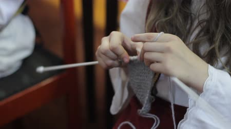 ручная работа : Womans hands are knitting clothes of wool