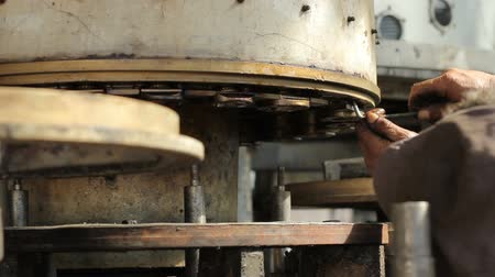 repair : The worker works with a hex key on the machine Stock Footage