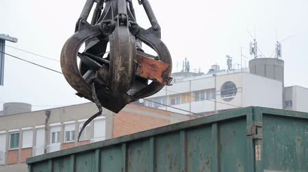 The excavators hand raised metal scrap for recycling Stock Footage