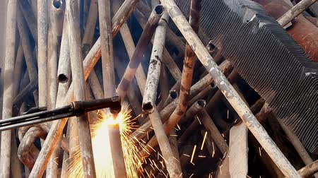 welding torch : Cutting metal pipes with gas that is transported for further processing in a smelter Stock Footage
