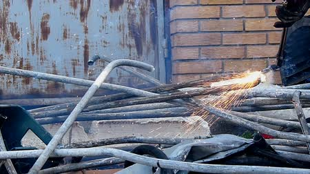 acetylene : Cutting metal pipes with gas that is transported for further processing in a smelter, slow motion