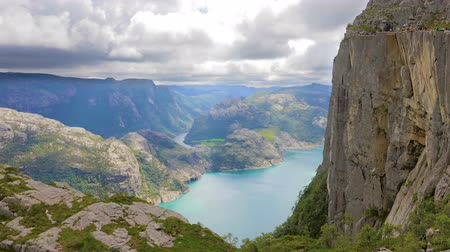 pulpit rock : Tourists hiking at the Preikestolen cliff in lysefjorden Norway Stock Footage