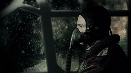 druhé světové války : A vigilant WWII fighter pilot flying his plane through a heavy rain and lightning storm.