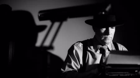 platen : A man in a fedora, typing on a vintage manual typewriter. Film Noir style lighting