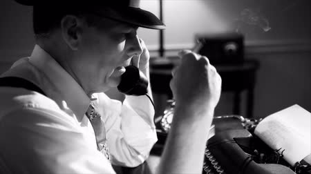 platen : A reporter in a fedora typing on a manual typewriter. Vintage 40s film noir look.