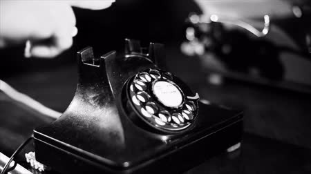 сбор винограда : A woman picks up the receiver of an old vintage rotary style telephone and appears to be unable to get a dail tone. Film noir