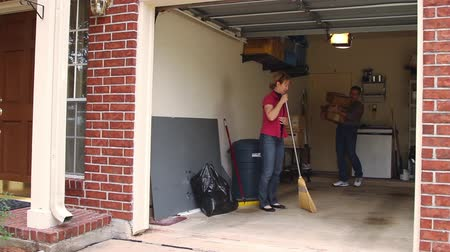 süpürge : Mature couple cleaning up their garage. Stok Video