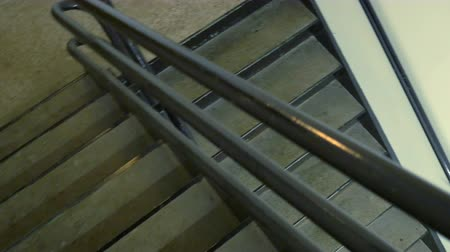 escada : POV view of walking down the emergency stairs in an office highrise building