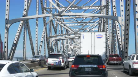 engineered : Driving in heavy traffic on the Mississippi bridge in Baton Rouge Louisiana 4K. Editorial.
