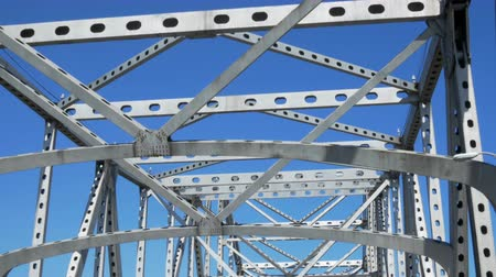 engineered : Driving under steel canopy of cantilever bridge which crosses over Mississippi River in Baton Rouge Louisiana. Stock Footage