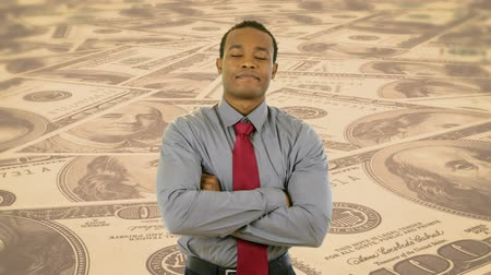 contentamento : A young African American urban professional on scrolling currency background. Stock Footage