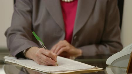 lengthy : Shallow DOF of attorney editing or marking up a legal document by hand