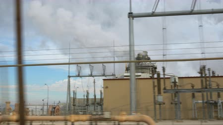 farpado : Driving along road next to a petrochemical plant or oil refinery. Stock Footage