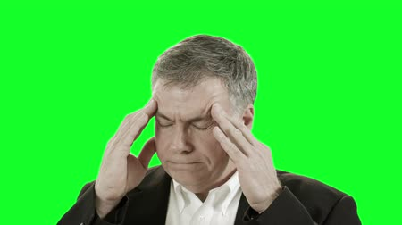 mračící : Businessman with a headache or migraine. Easy to key out and add your own background. Dostupné videozáznamy