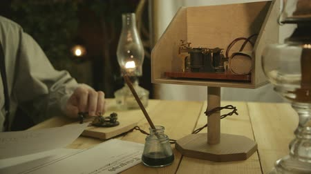 kodeks : A message being sent via Morse code from a makeshift telegraph office set up in rustic surrounding.