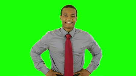 contentamento : An attractive young smiling African American businessman. Green Screen. Easy to key out and add your own background.